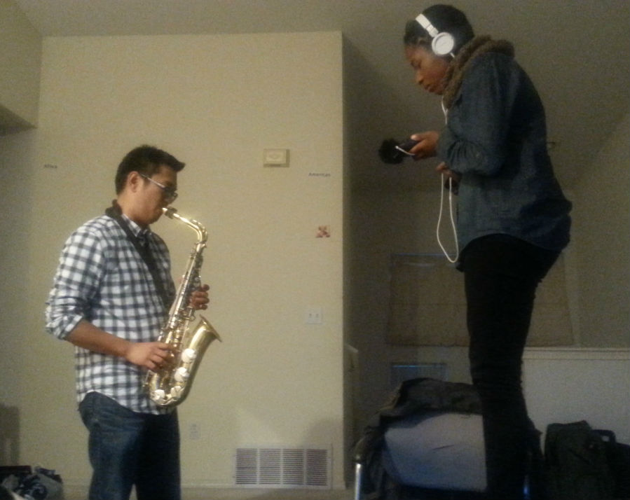 Ann Kane recording Steven Ono playing the saxophone.