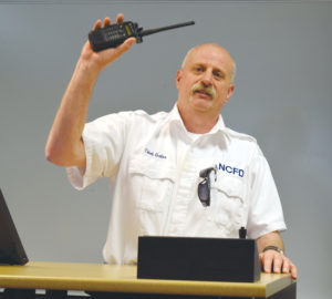 New Concord Fire Chief Brent Gates introduces Orbit Media's new 911 scanner March 14, 2016.